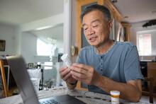 Senior Man Seeking Medical Advice On Video Call