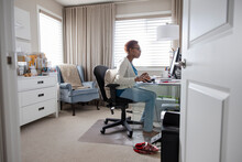 Senior Woman Working On Computer In Home Office