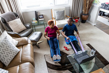 Senior Couple Exercising With Resistance Band At Home