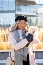 Portrait Beautiful Young Woman In Beret And Scarf With Small Dog
