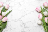 Fototapeta Tulipany - Beautiful tulips  on white marble table, flat lay. Space for text