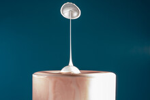 Two Drops Of Milk Fall Into The Long Drink Glass Hitting Each Other Then The Liquid Surface Is Shaped Like A Mushroom