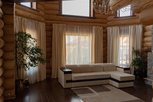Interior In Country Style Living Room In A Wooden House Made Of Solid Timber