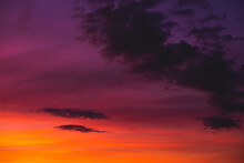 Bright Colorful Sunset Sky With Few Clouds