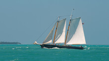 Sailboat Or Sail Yacht With American Flag. Private Cruise Tour. Summer Vacations On Ocean Or Gulf Of Mexico Florida. Yachting Sport. Turquoise Ocean Color. Beautiful Seascape.