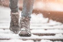Girl In Boots Walking On Rails In Winter