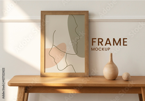 Wooden Picture Frame Mockup on Sideboard Table