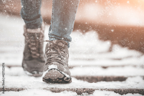Fototapeta girl in boots walking on rails in winter