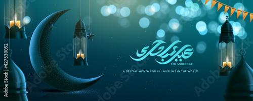 Stampa su Tela Ramadan Kareem Greeting Card With Hanging Lamps Crescent Shimmering Blue Backgro