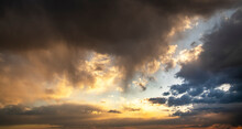 Sunset Sky Background. Beautiful Sunset After Rain, With Bright Orange Dramatic Clouds.