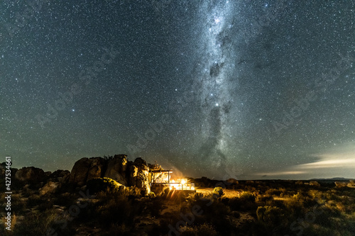 Canvas Scenery night sky with Milky way and million of stars with camping fire lights