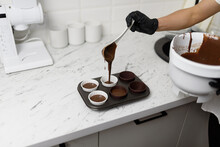 Chocolate Cake Batter Is Poured Into A Mold With Beautiful Paper Cups.