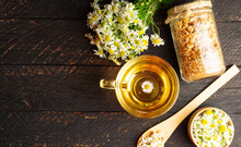 Cup Of Herbal Chamomile Tea With Fresh Daisy Flowers Background, Treatment And Prevention Of Immune Concept, Medicine - Folk, Alternative, Complementary, Traditional Medicine
