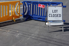 Lot Closed - Temporary Traffic Sign And Road Block At A Parking Lot Entrance