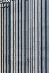 The corrugated steel sides of a storage silo at a flour mill