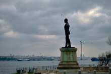 Turkey Istanbul 04.03.2021. Ataturk Founder Of Turkish Republic Sculpture In Sarayburnu Istanbul During Overcast Weather And Bosporus Istanbul Background.