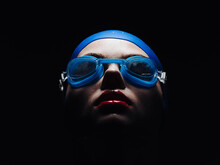Sportswoman On A Black Background In Goggles For Swimming Portrait Close-up