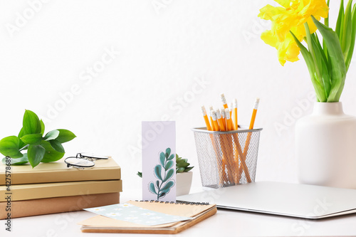 Obraz Stationery and flowers on table in office - fototapety do salonu