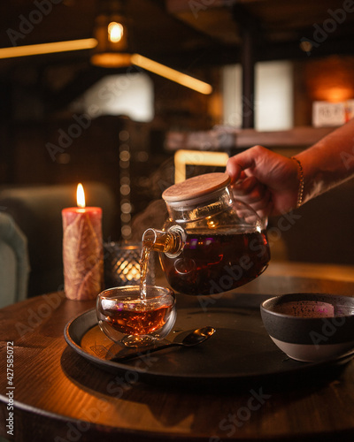 Canvas Tea brewing process, tea ceremony, freshly brewed black tea cup, warm soft light, dark background