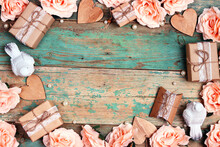 Festive Background With Rose Flowers, Gifts And Birds On Shabby Wooden Turquoise Boards. Frame Top Down Composition With Copy Space.