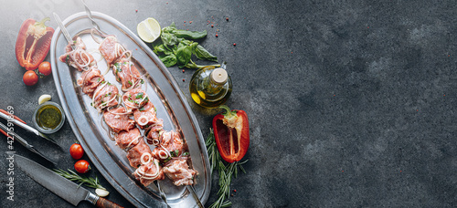 Fototapeta marinated meat for barbecue. Meat skewered and ready to grill obraz