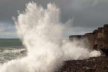 Power Full Ocean Wave Breaks On Rock Shore Line Creating Big Splash Of Water. Storm On West Coast Of Ireland. Power Of Nature Concept.