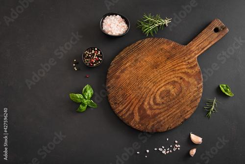 Fototapeta Empty wooden  board on black table