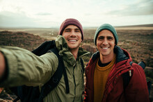 Caucasian Male Friend Taking Selfie With Cellular Device Smiling While On Outdoor Hike