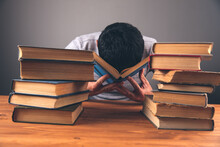 Covered His Face With His Hands In Front Of Books