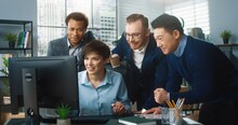 Portrait Of Beautiful Young Happy Caucasian Female Worker Typing On Computer Browsing Online Closing Deal And Feeling Excited. Multi-ethnic Co-workers In Cabinet In Good Mood. Company Office Concept