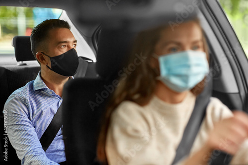 Fotografie, Obraz transportation, health and people concept - female driver driving car with male