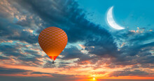 Night Sky Concept - Hot Air Balloon Over The Sunset Clouds With Crescent Moon