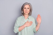 Photo Of Serious Mature Woman Grandmother Hold Hand Chest Giving Oath Pledge Isolated On Grey Color Background
