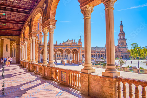 Walk along the arcaded balustrade in Plaza de Espana in Seville