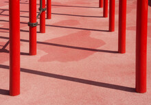 Red Metal, Iron Structures On An Outdoor Sports Ground With A Shadow On A Pink Surface, Background