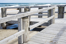 Beach Access Made Of Wood With Railings On The Baltic Sea Beach In Kühlungsborn With A Blue Sea, Mecklenburg, East Germany, Baltic Sea