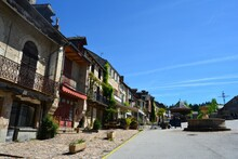 The Narrow And Picturesque Alleys Of Najac. Old Stone Houses Decorated With Flowers. South France.