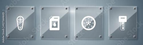 Fotografie, Obraz Set Car key with remote, Alloy wheel, Canister for motor oil and Timing belt kit