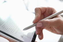 Female Hand Puts Electronic Signature In Tablet With Stylus