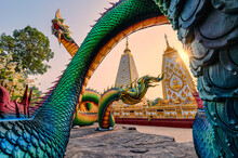 Rainbow Carve Serpent Or Colorful Thai Naga Surrounding Sri Maha Pho Chedi Stupa In The Sunset At Wat Phra That Nong Bua