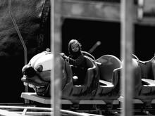 Full Length Of Man Sitting At Amusement Park