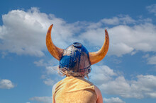 Rear View Of Person Wearing Hat Against Sky