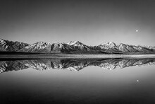 Scenic View Of Snowcapped Mountains Against Sky Reflected On Lake