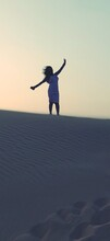Silhouette Woman On Sands Of Desert