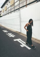 Full Length Of Young Woman Standing On A Japanese Road