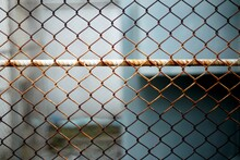 A Steel Fence Which Have Rust To Safety Zone Of The High Voltage Electric.