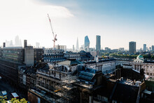 Cityscape Of The City Of London. High Angle View A Sunny Day In The Morning With Sun Flare