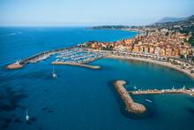 Aerial View Of Buildings By Sea Against Sky