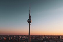 Communications Tower In City Against Clear Sky During Sunset
