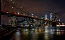 Illuminated Brooklyn Bridge Over Hudson River